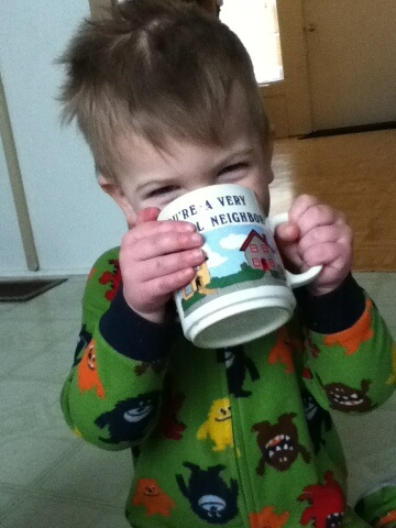 toddler drinking hot cocoa