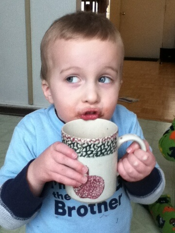 little boy drinking hot chocolate