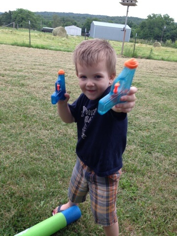 toddler with squirt guns