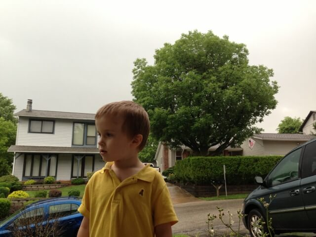 young boy in rain