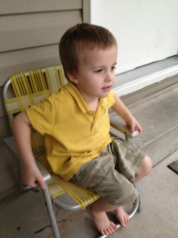 little boy on lawn chair