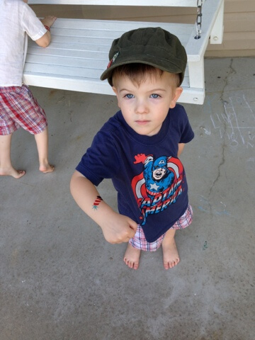 little boy with hand painted 4th of july tattoo