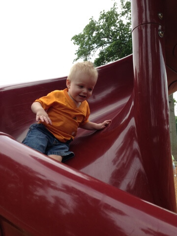 toddler going down slide