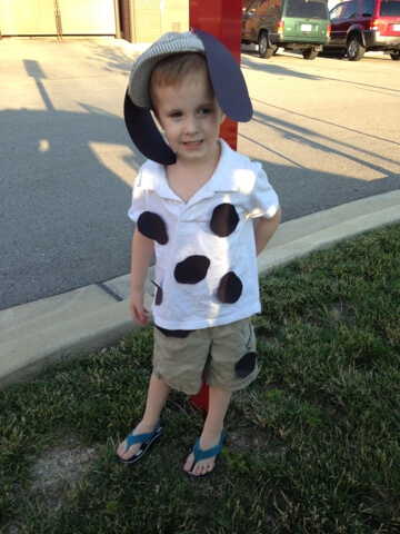 boy wearing home made cow costume
