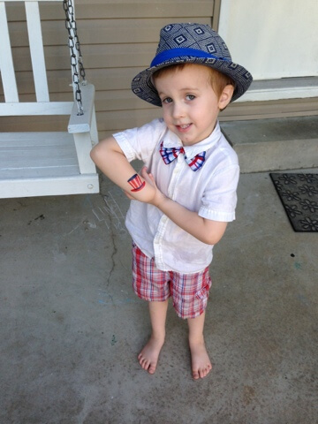 boy with patriotic painted tattoo