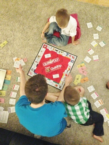 dad and boys playing monopoly
