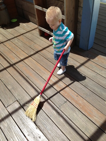 toddler boy sweeping