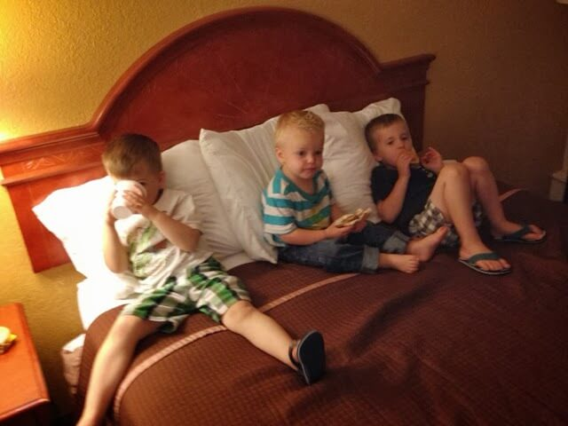 3 boys on hotel bed