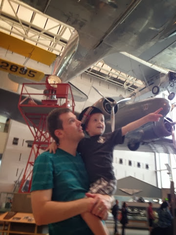 dad and boy at air and space museum