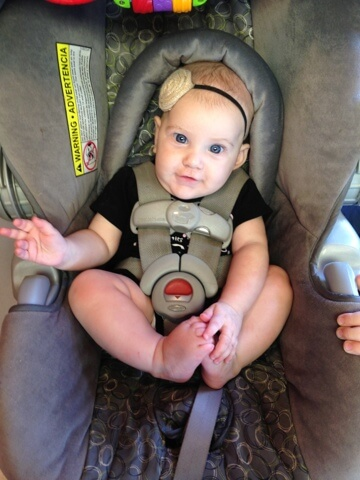 cute baby girl in carseat
