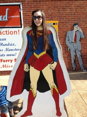 young woman with superwoman cut out