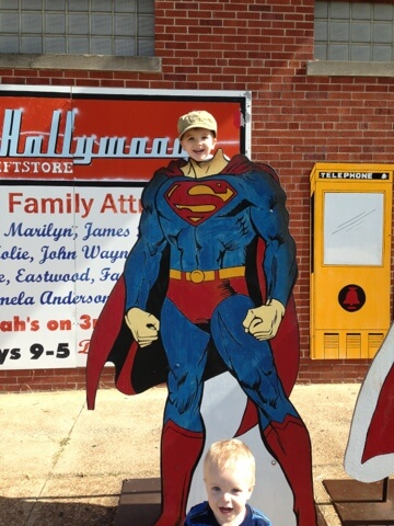 little boy with superman cut out
