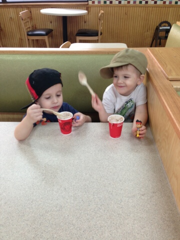 2 boys eating frostys from wendys