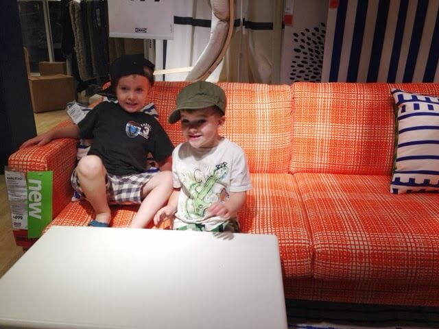brothers on orange couch