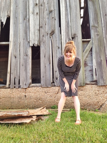 woman posing in front of barn