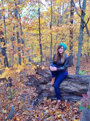 young woman on fallen tree