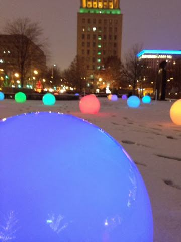 glowing colored spheres at city garden