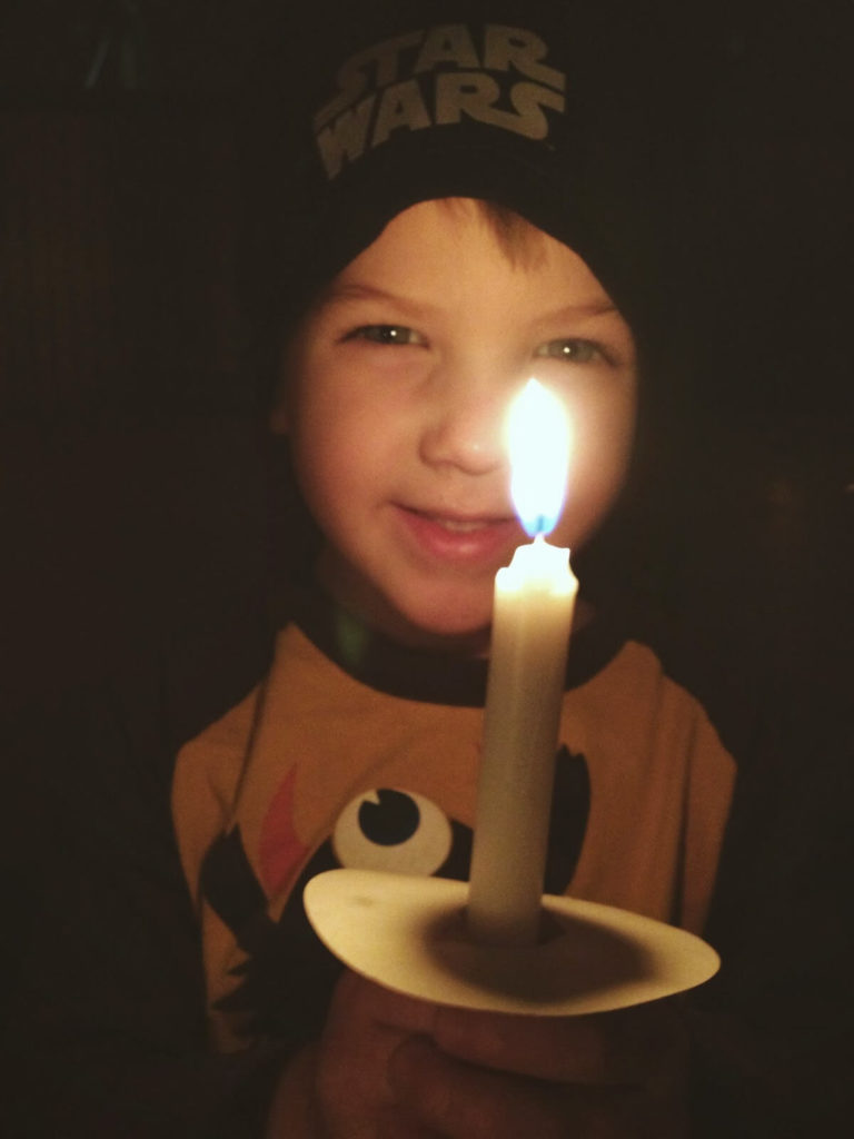 little boy with candle