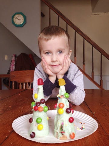 boy and homemade candy christmas tree