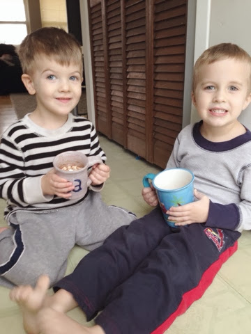 boy and little brother drinking hot chocolate