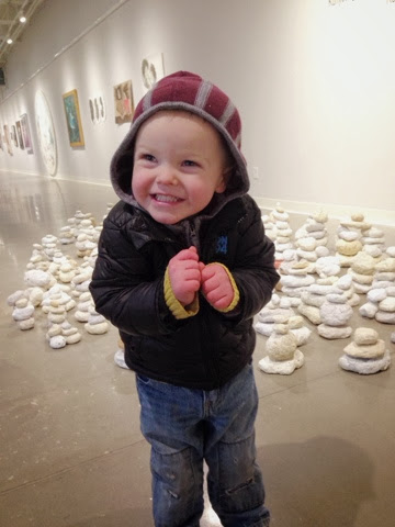 toddler boy warming up in foundry art center