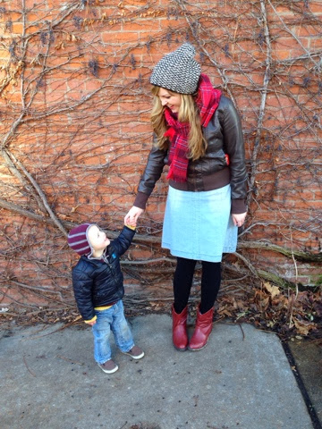 woman and toddler posing by vine wall