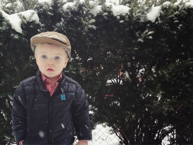 cute toddler boy in snow