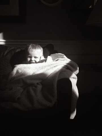 toddler boy under covers
