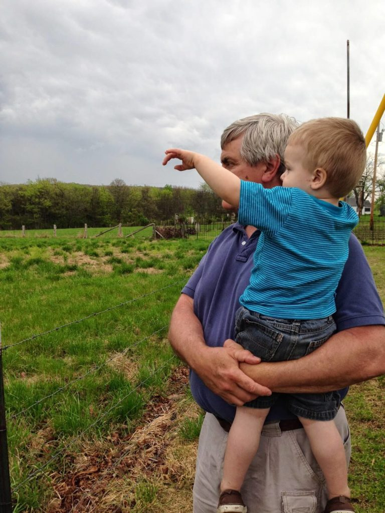 grandpa and toddler boy pointing