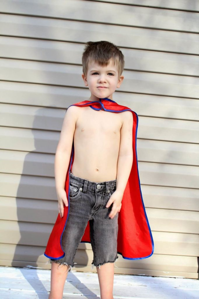 little boy with cape