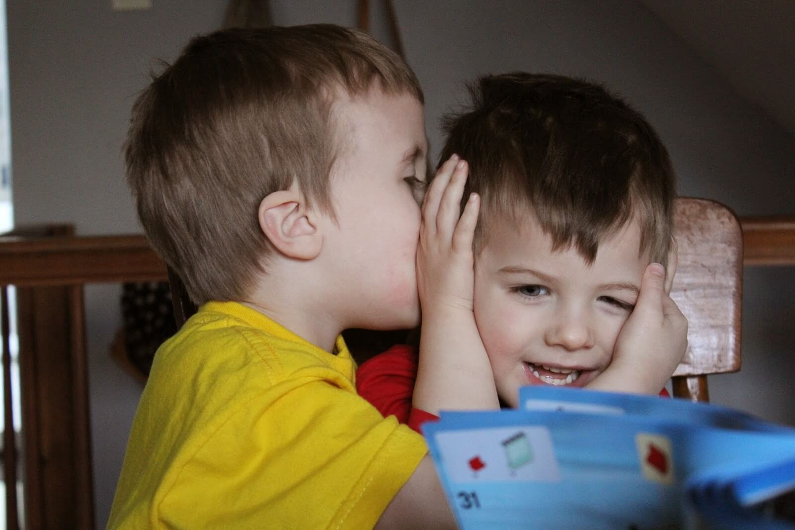 boy whispering to little brother