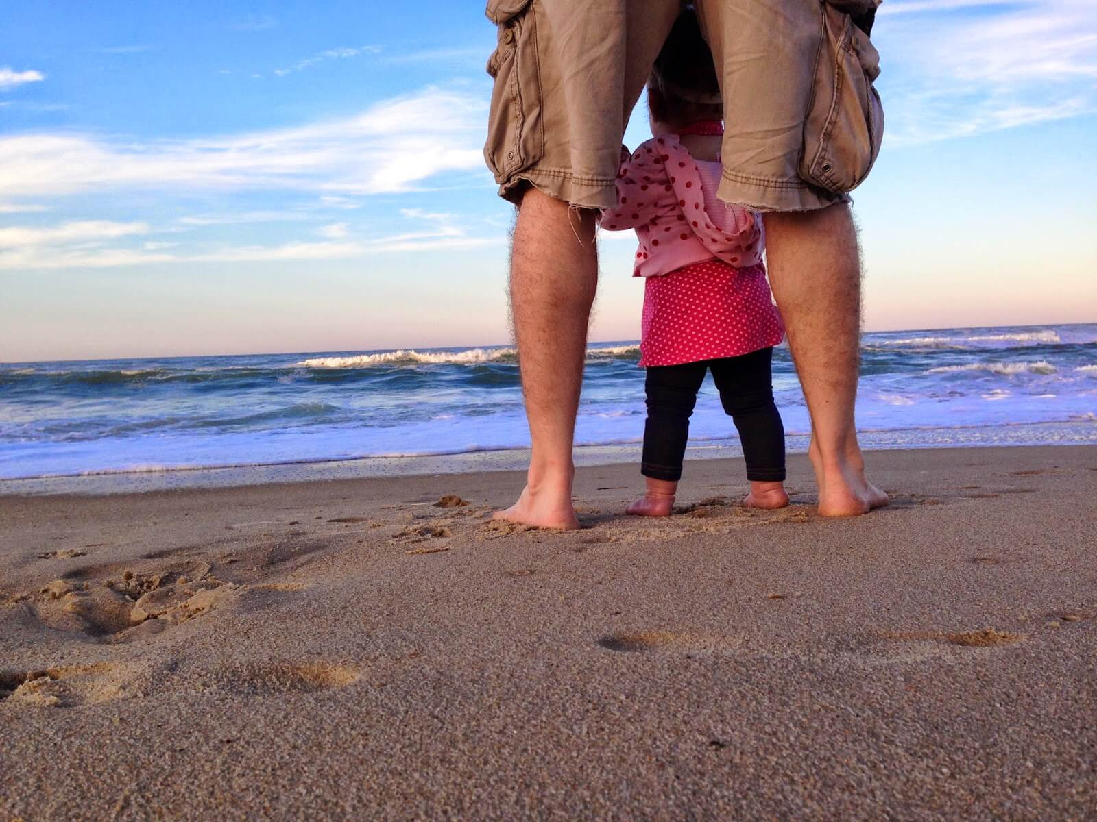 dad and baby looking at ocean