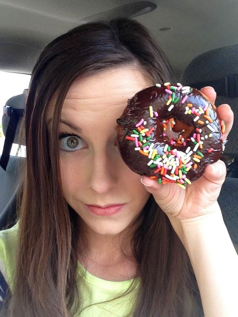 chocolate sprinkle donut over womans eye