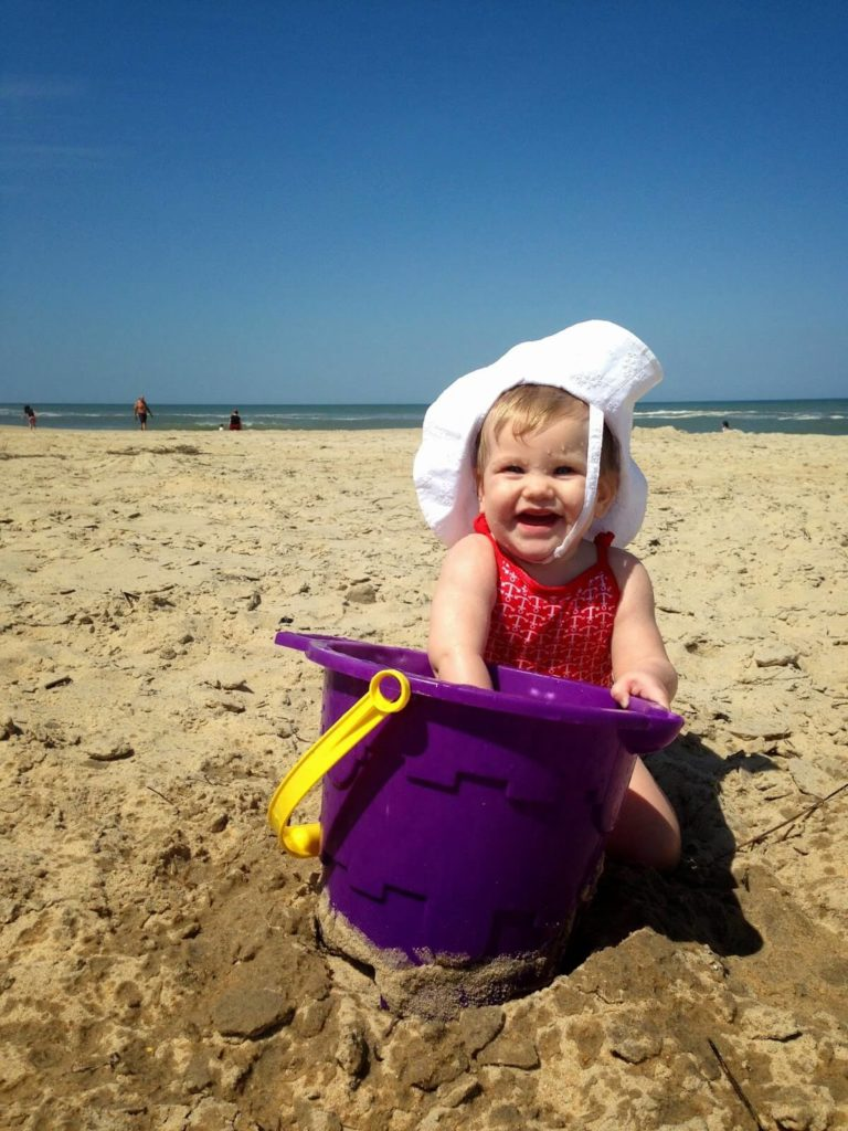 cute baby playing on beach