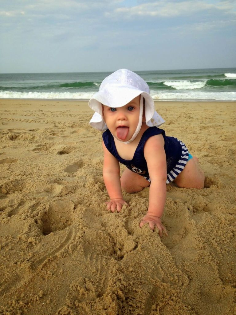 cute baby girl playing in sand