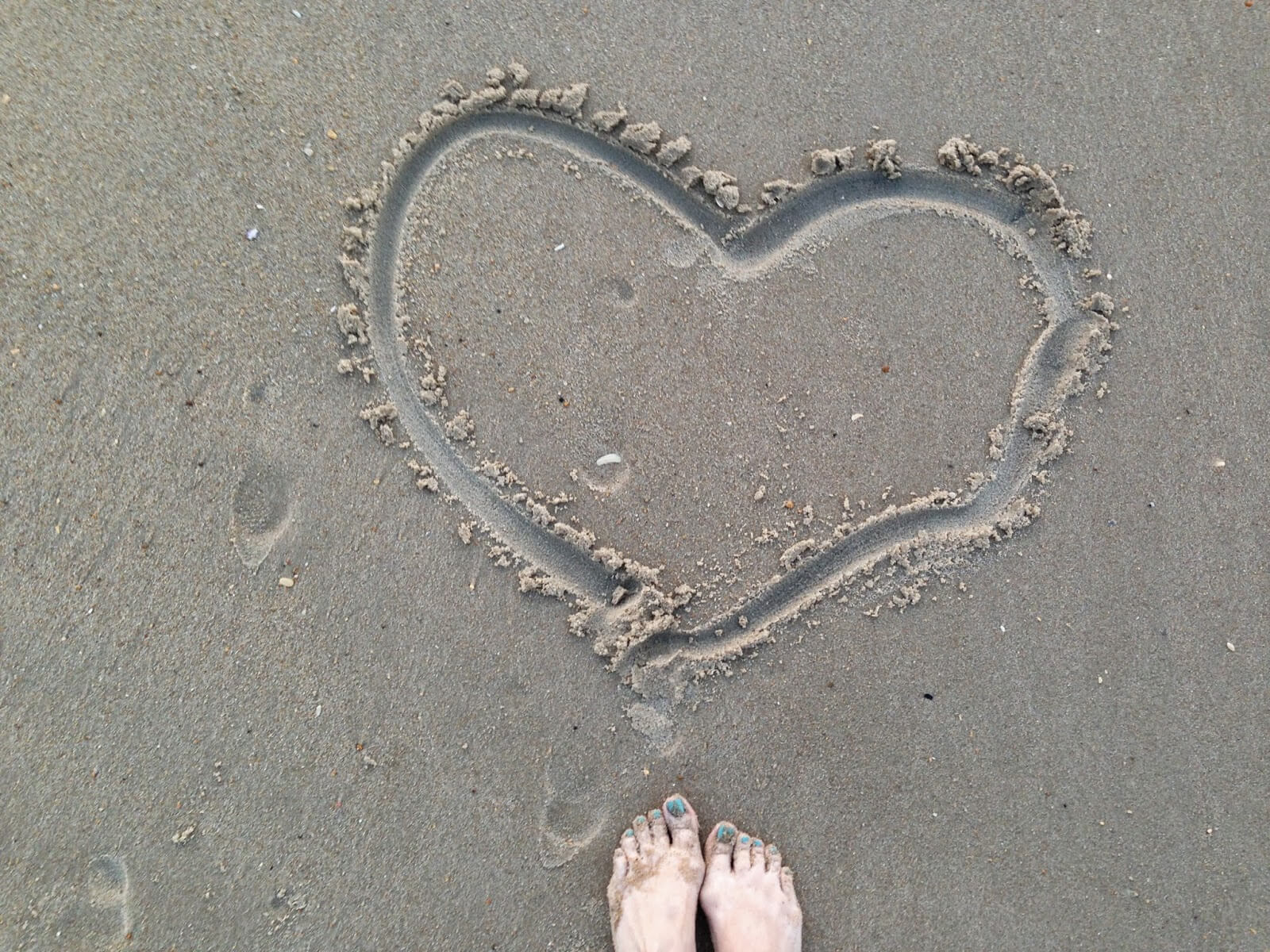 drawing hearts in the sand