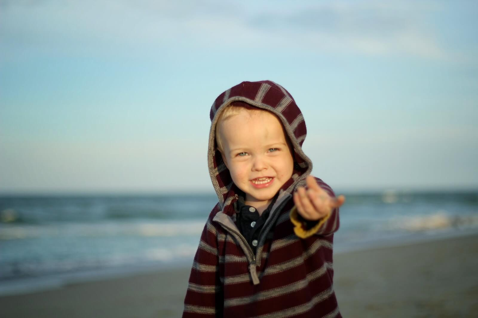toddler showing seashell