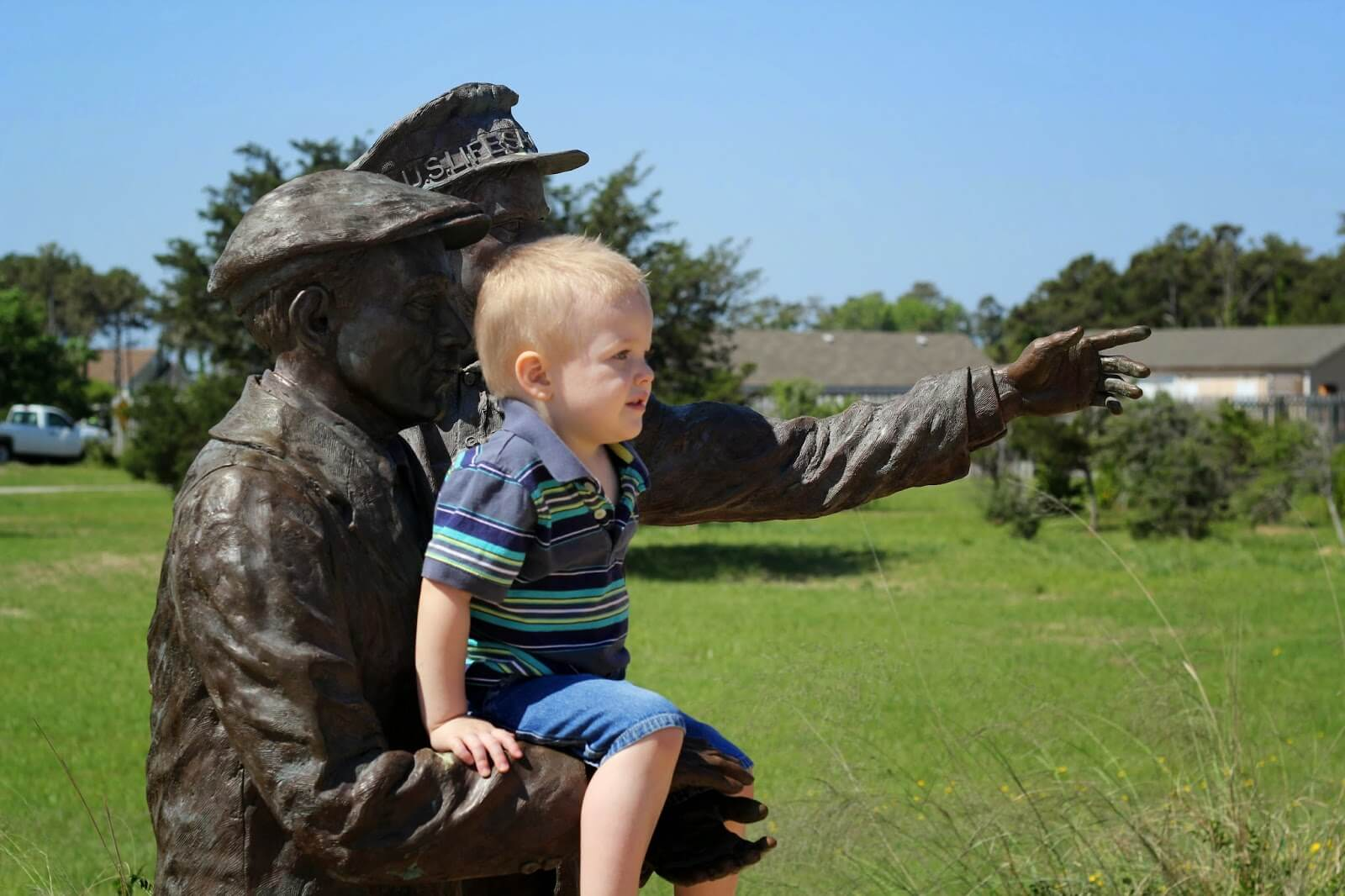 toddler sitting on statue
