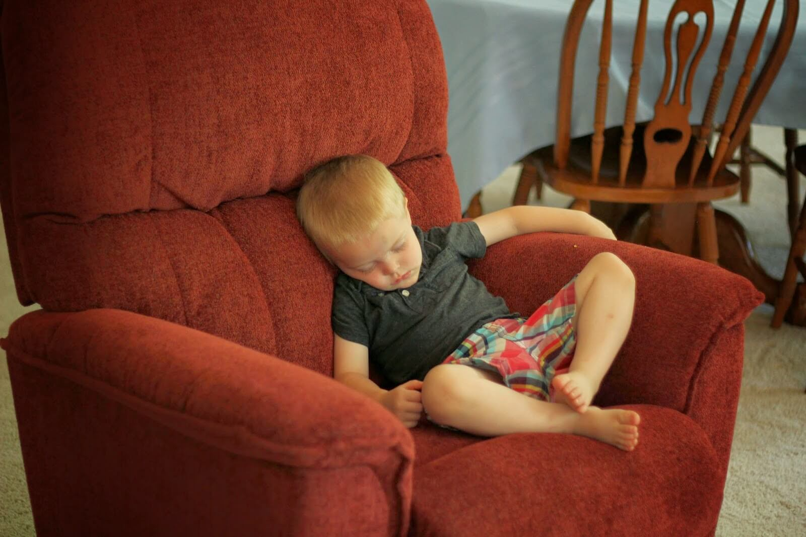 toddler boy sleeping in chair