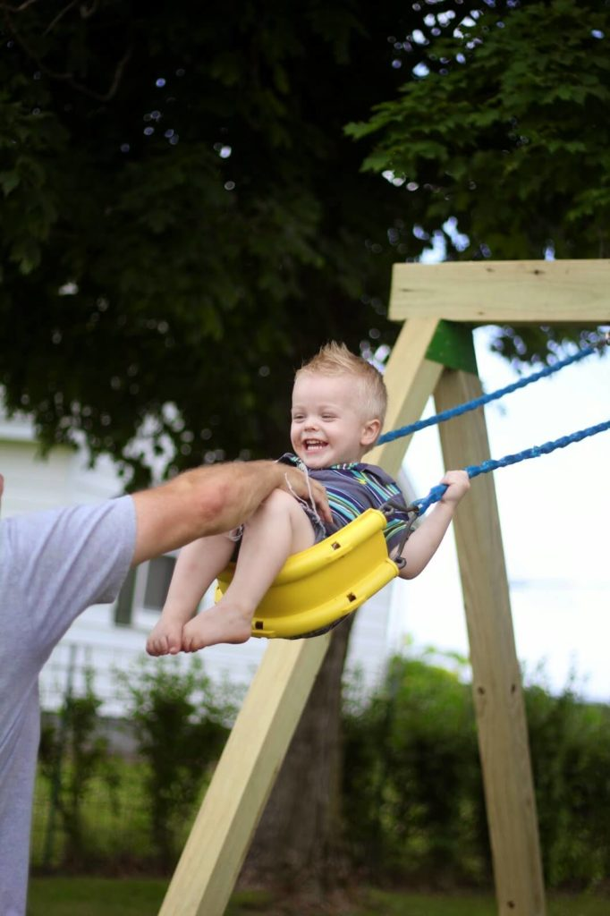 toddler boy swinging