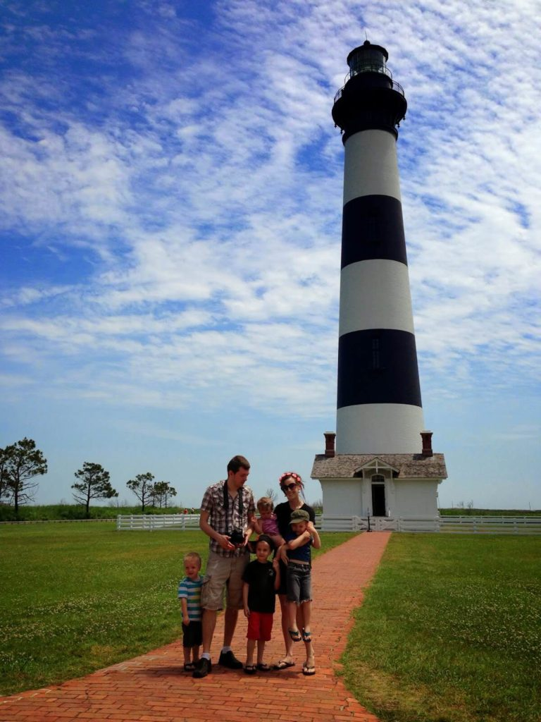 big family at lighthouse
