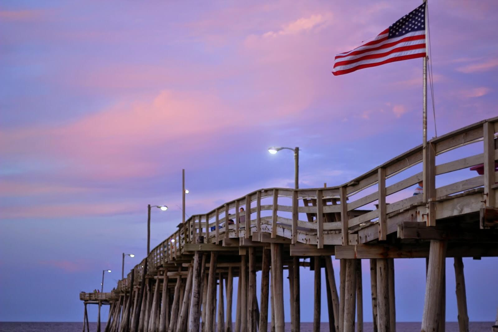american flag at pier