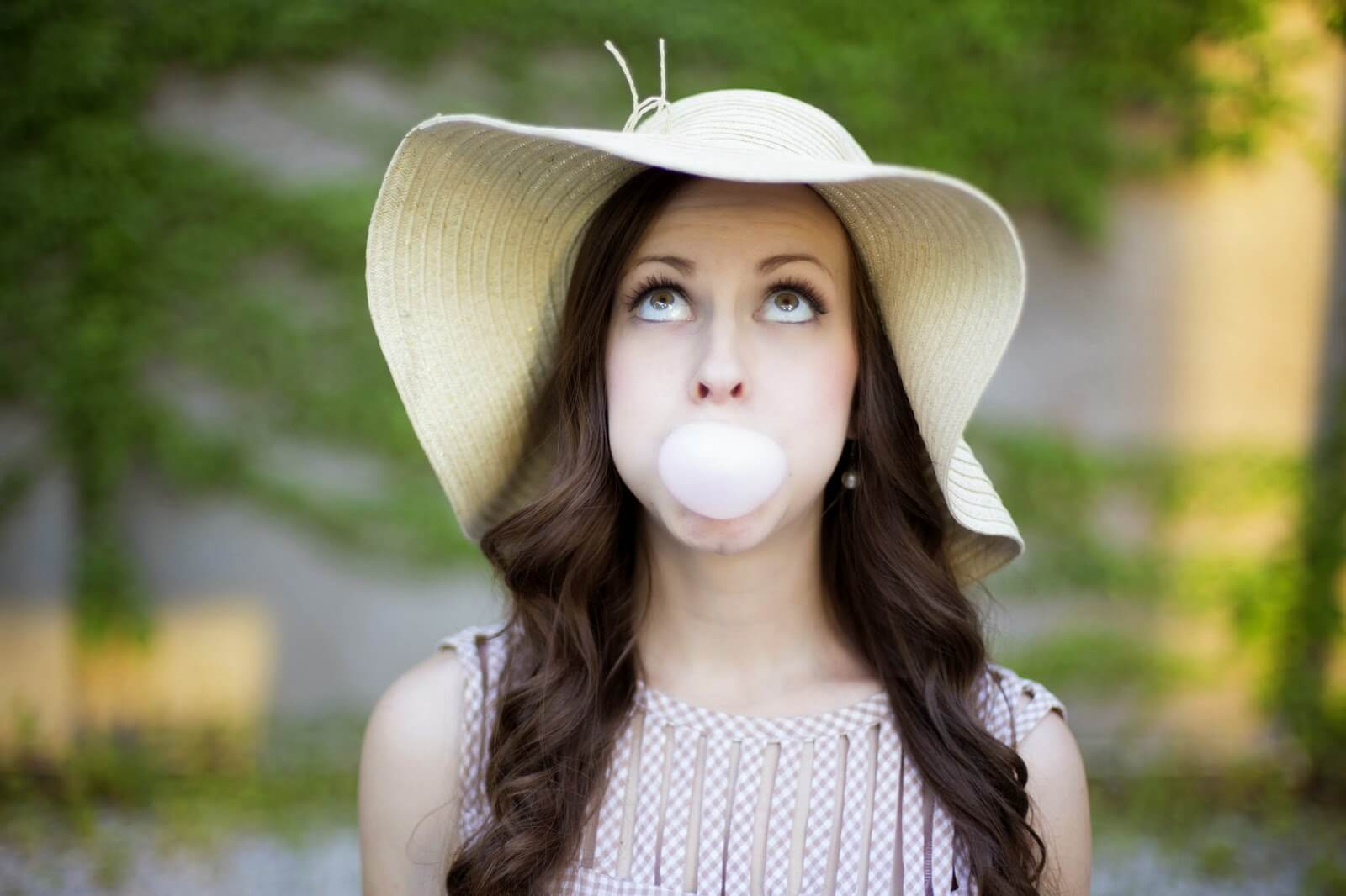 chewing gum and blowing bubbles