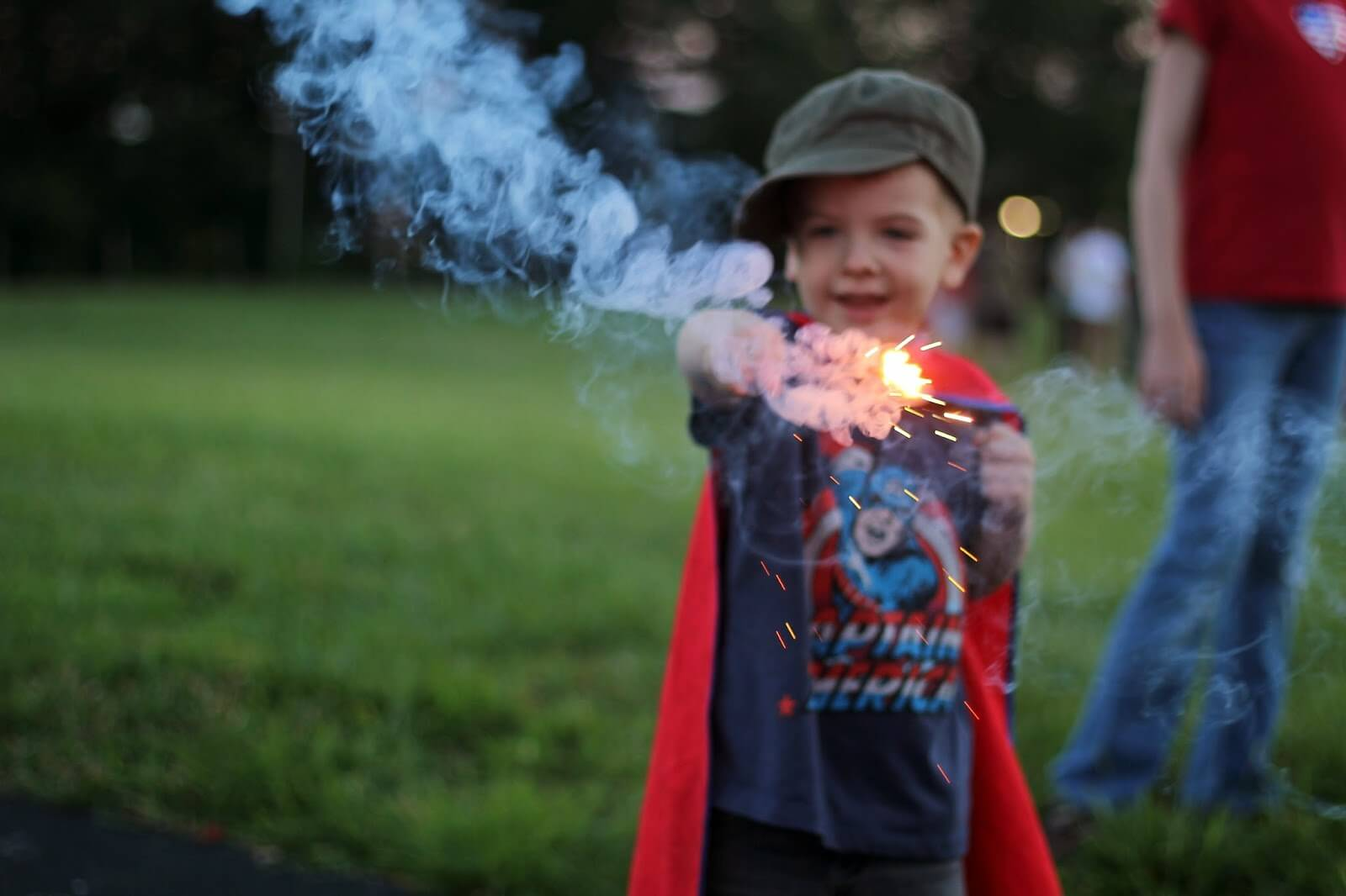 young boy playing with sparkler