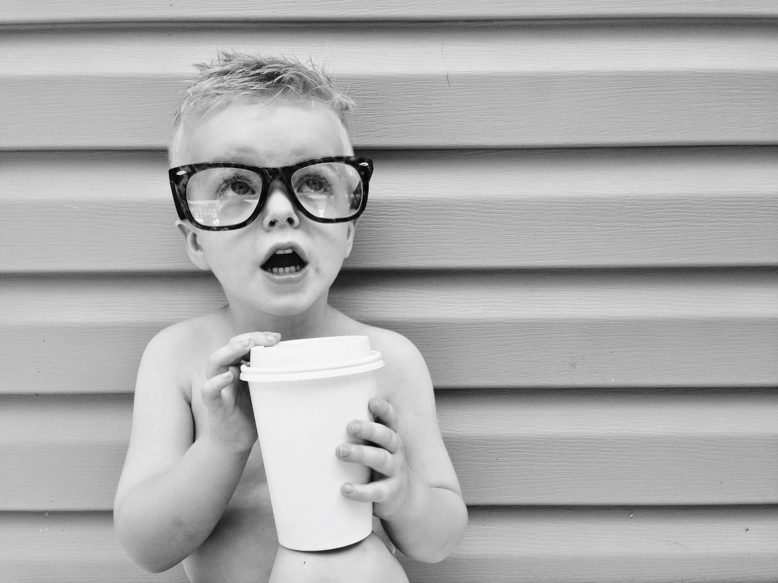 funny toddler with glasses and coffee