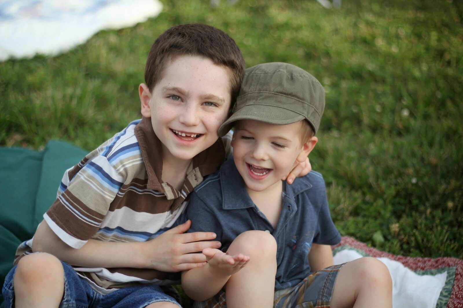 two little boys smiling