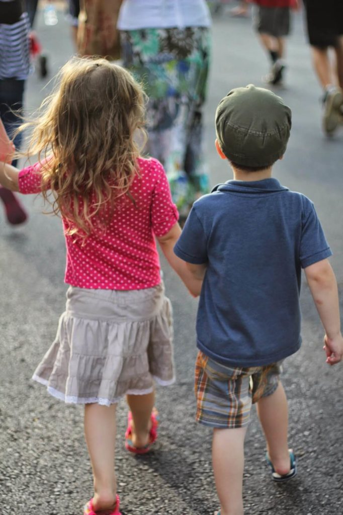 little boy and girl holding hands