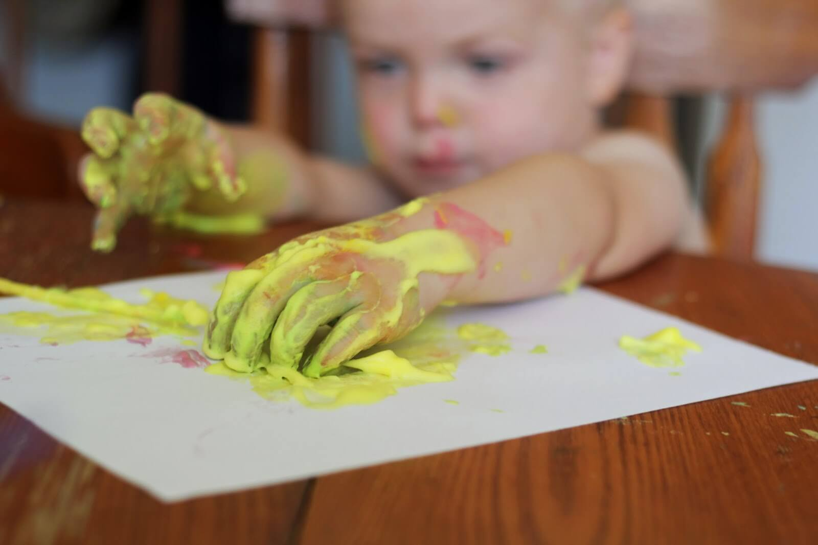 kids paint with fingers