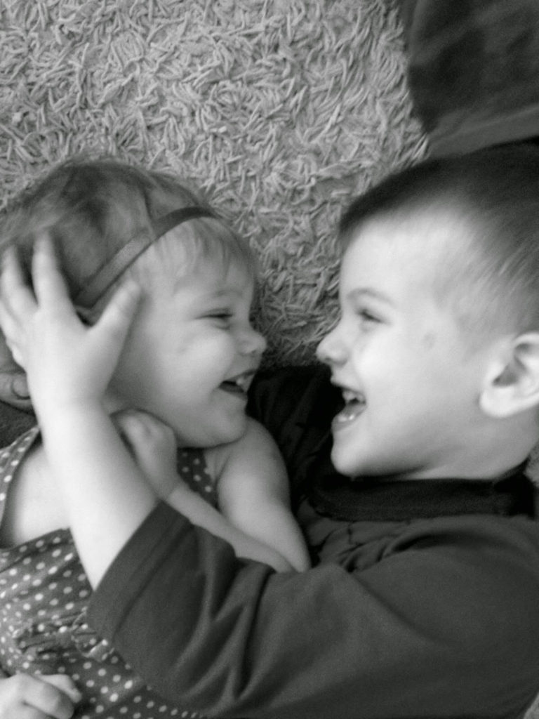 young boy with baby girl sister
