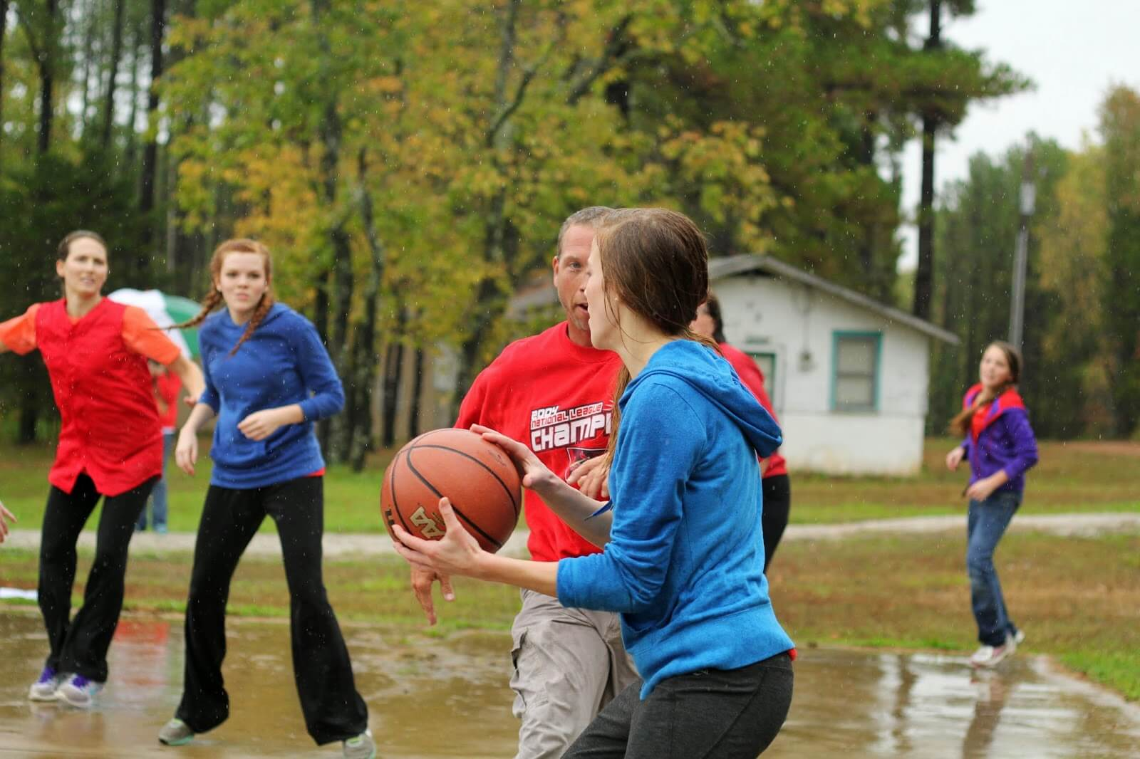 playing backetball in the rain